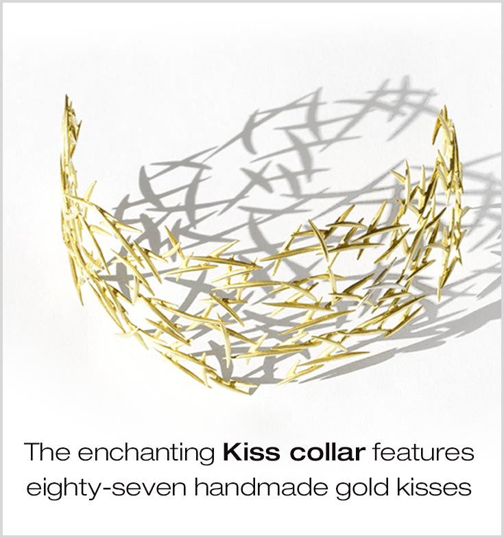 The decadent Kiss collar features eight-seven hand-made gold kisses